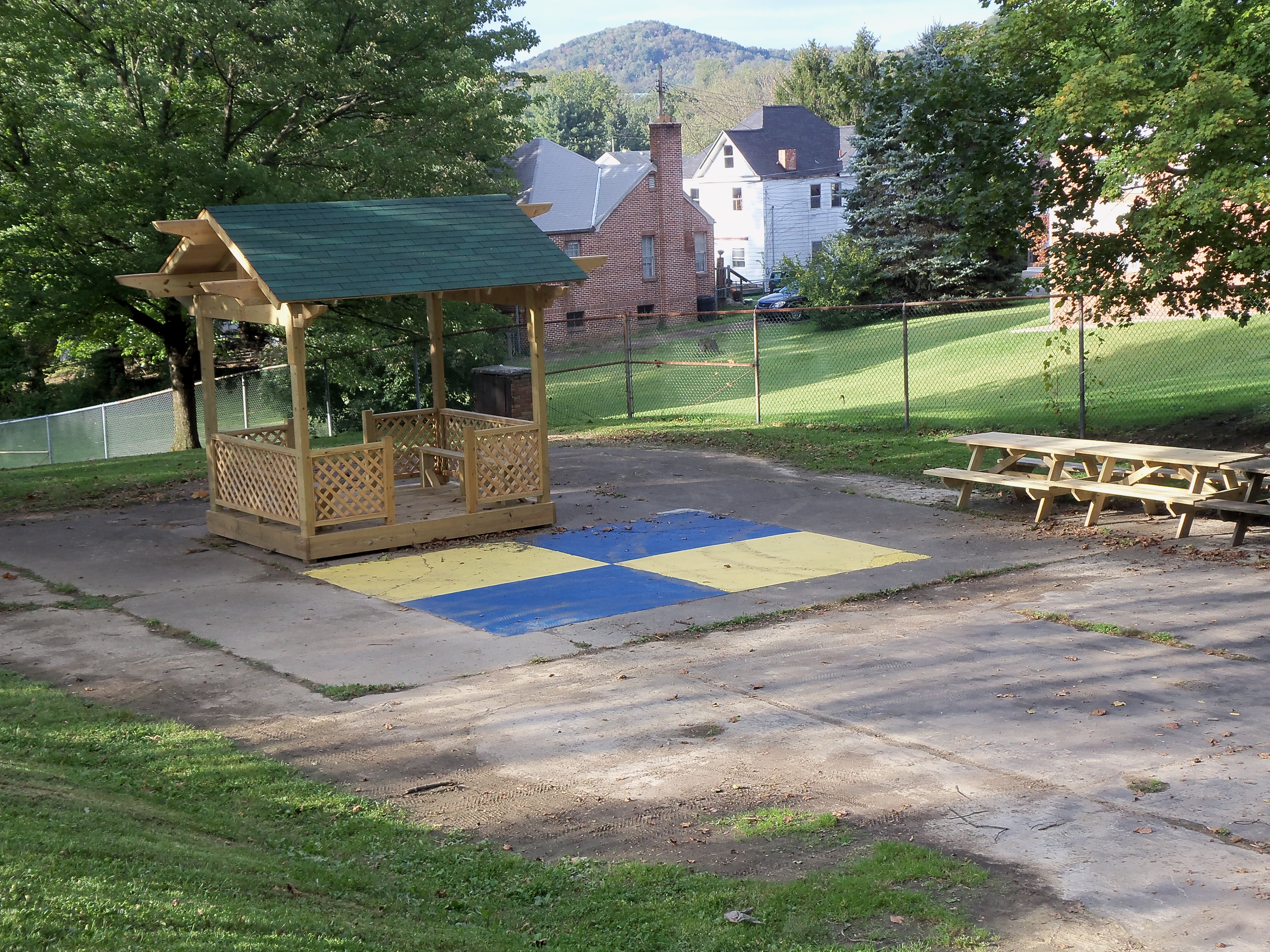4-Square Game Next to Little Shelter at Park